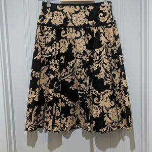 Joneswear black skirt with beige floral pattern